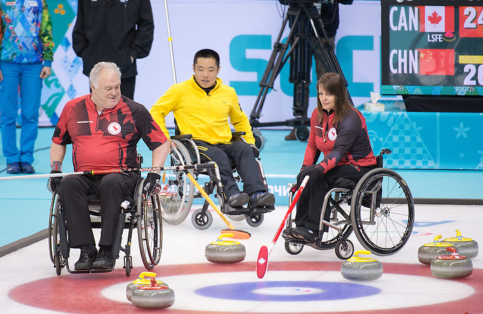 Sochi, RUSSIA - Mar 15 2014 - Jim Armstrong and Ina Forrest as Canada takes on China in the semi finals of Wheelchair Curling  at the 2014 Paralympic Winter Games in Sochi, Russia.  (Photo: Matthew Murnaghan/Canadian Paralympic Committee)