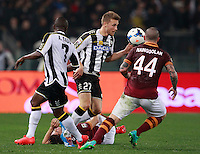 Calcio, Serie A: Roma vs Udinese. Roma, stadio Olimpico, 17 marzo 2014.<br /> From left, Udinese midfielder Emmanuel Badu, of Ghana, and Udinese defender Silvan Widmer, of Switzerland, and AS Roma midfielder Radja Nainggolan, of Belgium, fight for the ball as AS Roma defender Dodo', of Brazil, lies on the pitch after being injured during the Italian Serie A football match between AS Roma and Udinese at Rome's Olympic stadium, 17 March 2014.<br /> UPDATE IMAGES PRESS/Isabella Bonotto