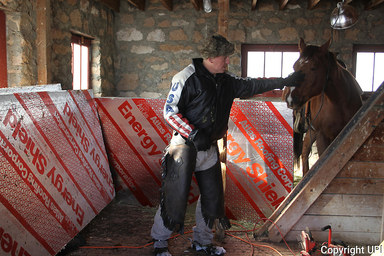 Duane Ehmer, of Irrigon, Oregon, gives his horse, Hellboy, a pat at the Malheur National Wildlife Reserve on January 15, 2016 in Burns, Oregon. Ehmer has been pulling sentry duty during the takeover. Ammon Bundy and about 20 other protesters took over the refuge on Jan. 2 after a rally to support the imprisoned local ranchers Dwight Hammond Jr., and his son, Steven Hammond.      Photo by Jim Bryant/UPI