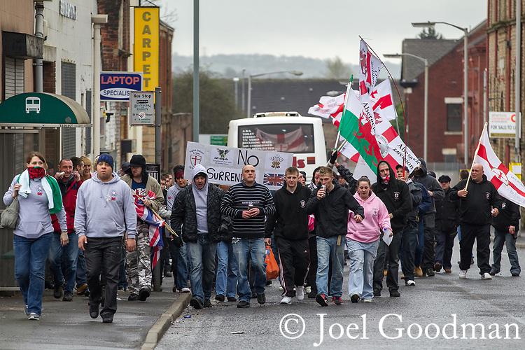 © Joel Goodman - 07973 332324 . 02/04/2011 . Blackburn , UK . EDL supporters arrive for the demonstration . The English Defence League ( EDL ) hold a demonstration in Blackburn . Photo credit : Joel Goodman