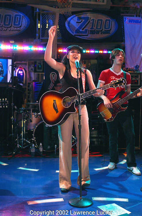 Recording artist Michelle Branch performs at the NBA Store May 20, 2002 in New York City. The concert kicked off the WNBA 2002 season.