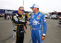 Jul. 28, 2013; Sonoma, CA, USA: NHRA top fuel dragster driver Tony Schumacher (left) with T.J. Zizzo during the Sonoma Nationals at Sonoma Raceway. Mandatory Credit: Mark J. Rebilas-
