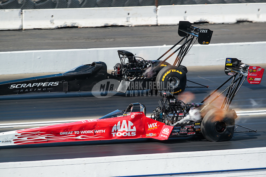 Feb 9, 2019; Pomona, CA, USA; NHRA top fuel driver Mike Salinas (far) races alongside Doug Kalitta during qualifying for the Winternationals at Auto Club Raceway at Pomona. Mandatory Credit: Mark J. Rebilas-USA TODAY Sports