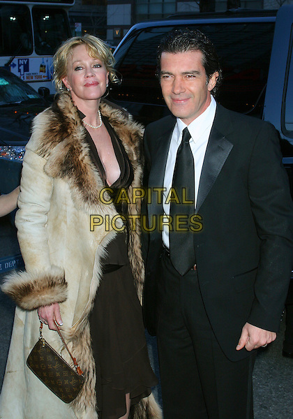 "MELANIE GRIFFITH & ANTONIO BANDERAS.""Take The Lead"" Film Premiere,. AMC Lincoln Square New York City, .New York, USA, 4th April 2006..half length married husband wife fur collar coat brown dress Louis vuitton bag.Ref: IW.www.capitalpictures.com.sales@capitalpictures.com.©Capital Pictures"