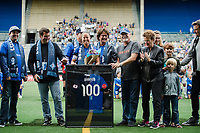 Seattle, WA - Sunday, August 13, 2017: Seattle Reign FC celebrates captain Lauren Barnes' 100th team appearance prior to a National Women's Soccer League (NWSL) match between the Seattle Reign FC and the North Carolina Courage at Memorial Stadium.