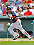 13 March 2012: Atlanta Braves outfielder Jose Constanza lays down a bunt during a Spring Training game against the Miami Marlins at Roger Dean Stadium in Jupiter, Florida. The two teams battled to a 2-2 tie playing 10 innings of Grapefruit League action. Mandatory Credit: Ed Wolfstein Photo
