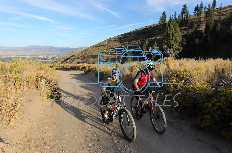Jeff Moser and his son Charlie ride the Ash Canyon trails in Carson City, Nev., on Friday, Sept. 14, 2012..Photo by Cathleen Allison