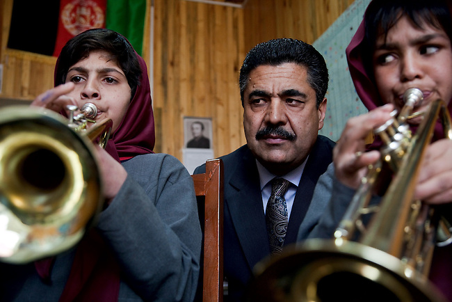 18 May 2012, Kabul Afghanistan: Dr Ahmad Nasir Sarmast  listens to orphan students Khalida Safai (left,10) and Meenaa Zinat (9) during a trumpet lesson. Dr Sarmast founded the Afghanistan National Institute of Music in Kabul that takes in students from all walks of Afghan life to educate them in musical studies. The World Bank is supporting this legacy by providing funding for a new concert hall and to gather additional land to expand the premises. Many of the students are orphans who would otherwise have no opportunity or access to the knowledge or instruments that the Institute has gathered. Up to half a dozen ex-patriate music  teachers run classes in music that ranges from traditional Afghan and classical  music to modern rock.  Picture by Graham Crouch/World Bank