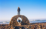 MEXICO, Baja, man standing on rock window sculpture, Seven Sisters, Baja Norte
