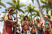 Indigenous leaders gather under palm trees beside the congress building for a demonstration in Brasilia, Brazil by the Xicrin, Kayapo and Pataxo tribes, 10th November 2015. Photo © Sue Cunningham, pictures@scphotographic.com