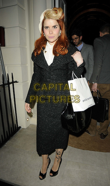 Paloma Faith.The Risque Buiness by Emilio Cavallini party, The Gallery at Sketch,  Conduit St., London, England..March 21st, 2012.full length black skirt jacket goody bag tattoo blonde dyed streak hair white hat.CAP/CAN.©Can Nguyen/Capital Pictures.