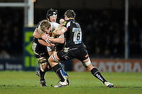 Simon Taylor of Bath Rugby (centre) is tackled by Peter Short (left) and David Ewers of Exeter Chiefs during the LV= Cup match between Exeter Chiefs and Bath Rugby at Sandy Park Stadium on Sunday 5th February 2012 (Photo by Rob Munro)