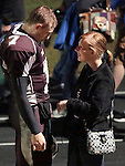 Kevin Whitaker greets his girlfriend Lindsay Couch, 18, after the football game at Leslie County High School in Hyden, Ky. on Friday, October 11, 2013.  Photo by Adam Pennavaria