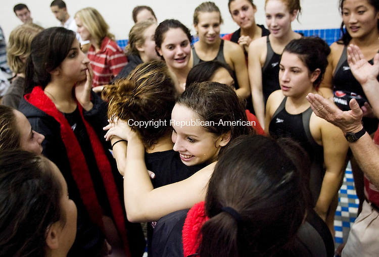 NEW HAVEN, CT--14 November 07--111407TJ14 - Cheshire swimmer Jessica Metcalf, center, hugs teammate Sydney Smith as final results are read at the Class LL Girls Swimming Championships at Southern Connecticut State University on Wednesday, November 14, 2007. T.J. Kirkpatrick/Republican-American