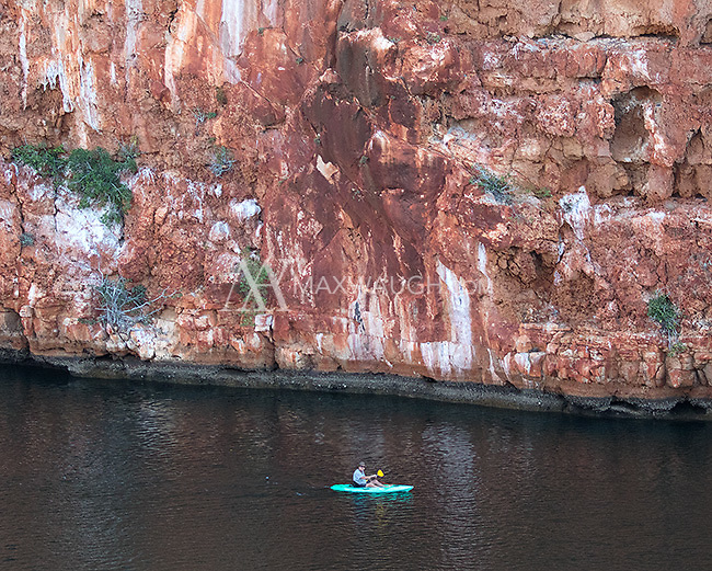 A visitor to Cape Range National Park kayaks the Yardie Creek gorge.