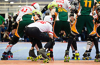 15 MAR 2014 - BIRMINGHAM, GBR - Team England jammer Reaper takes a low stance as he waits for the start of a jam during the bout against the Wizards of Aus at the inaugural Men's Roller Derby World Cup in the Futsal Arena in Birmingham, West Midlands, Great Britain (PHOTO COPYRIGHT © 2014 NIGEL FARROW, ALL RIGHTS RESERVED)