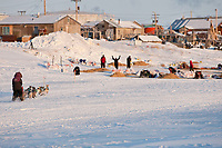 Michelle Phillips runs on the Unalakleet slough as she approaches the check-in area at Unalakleet in Arctic Alaska during the 2010 Iditarod