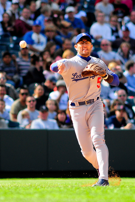 14 September 08: Los Angeles Dodgers 3rd baseman Nomar Garciaparra throws to 1st base for an out against the Colorado Rockies. The Colorado Rockies defeated the Dodgers 1-0 in 10 innings at Coors Field in Denver, Colorado. FOR EDITORIAL USE ONLY