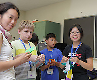 Michelle Fung teaching a class her origami Android design.
