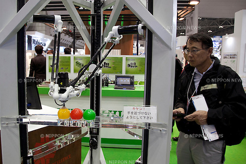 """Visitor sees the HIWIN """"Movable Parallel Robot"""" at the International Robot Exhibition 2013 in Tokyo, Japan, November 6, 2013. The IREX is the largest robot trade fair in the world and shows new robots and high technology equipments at theTokyo International Big Sight. The exhibitions runs from November 6 to 9. (Photo by Rodrigo Reyes Marin/AFLO)"""