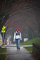 An Otterbein College students walks in the rain between classes during a fall rain storm.
