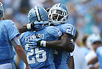 01 September 2012: UNC's Giovani Bernard (26) celebrates his third touchdown with Romar Morris (21). The University of North Carolina Tar Heels played the Elon University Phoenix at Kenan Memorial Stadium in Chapel Hill, North Carolina in a 2012 NCAA Division I Football game. UNC won the game 62-0.