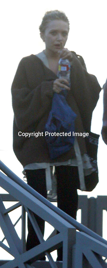 4-14-09  .Mary Kate Olsen leaving her Yoga Studio in Brentwood ca near Los Angeles looking very sweaty & very shy ...AbilityFilms@yahoo.com.805-427-3519.www.AbilityFilms.com.