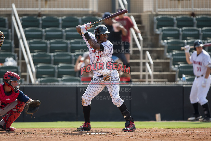 Micker Adolfo (27) of the Kannapolis Intimidators at bat against the Hagerstown Suns at Kannapolis Intimidators Stadium on July 9, 2017 in Kannapolis, North Carolina.  The Intimidators defeated the Suns 3-2 in game one of a double-header.  (Brian Westerholt/Four Seam Images)