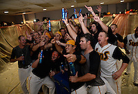 Jacksonville Suns Players celebrate in the locker room after clinching the Southern League Championship Series against the Chattanooga Lookouts on September 12, 2014 at Bragan Field in Jacksonville, Florida.  Jacksonville defeated Chattanooga 6-1 to sweep three games to none.  (Mike Janes/Four Seam Images)