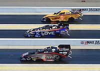 Apr. 14, 2012; Concord, NC, USA: NHRA funny car drivers Jeff Arend (top), Tony Pedregon (middle) and Blake Alexander race during qualifying for the Four Wide Nationals at zMax Dragway. Mandatory Credit: Mark J. Rebilas-