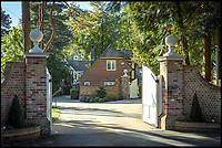 BNPS.co.uk (01202 558833)<br /> Pic: Savills/BNPS<br /> <br /> Three-mendous!<br /> <br /> The entance and gate house.<br /> <br /> Stunning seaside estate overlooking Sandbanks that wouldn't look out of place in the Hollywood Hills - and you get three properties for your &pound;9 million price tag.<br /> <br /> You get three luxury homes for the price of one with this spectacular private coastal estate - but they will still need deep pockets as the trio of properties are on the market for &pound;8.995m.<br /> <br /> The Mulberry House Estate is in the leafy Canford Cliffs area of Poole, Dorset, and has a grand five-bedroom mansion, a second detached five-bedroom house and a two-bedroom gate house.<br /> <br /> Locals describe the Canford Cliffs area as the 'Hollywood Hills' of the coastal property hotspot, more refined and less showy than the more 'Malibu style' Sandbanks peninsula that it overlooks.<br /> <br /> Offering beautiful views but with privacy and seclusion, and without the tourist crowds that the Sandbanks millionaire's enclave attracts.<br /> <br /> Estate agent Savills say the sale is a &quot;unique opportunity&quot; as the 2.2 acre Mulberry property is the only private estate in the area.