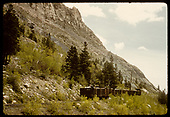 Train hauling gondolas filled with rock in Monarch area.<br /> D&amp;RGW  Monarch, CO