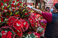 NEW YORK, NY - MAY 10: A man wearing a face mask points to the bouquet of flowers he has in a warehouse in Jackson Heights on Mother's Day on May 10, 2020 in Queens, New York. COVID-19 has spread to most countries in the world, claiming more than 283,000 lives and more than 4.1 million people infected, Queens has been one of the places most affected by the Coronavirus. (Photo by Pablo Monsalve / VIEWpress via Getty Images)