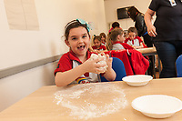Megan Horbury (6) has fun with some dough at ASDA Newark!
