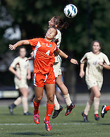 University of Miami defender Allie Rossi (4) and Boston College forward Victoria DiMartino (1) battle for head ball. .After two overtime periods, Boston College (gold) tied University of Miami (orange), 0-0, at Newton Campus Field, October 21, 2012.
