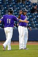 Akron Aeros outfielder Carlos Moncrief #24 and Kyle Bellows #11 after scoring runs during a game against the Trenton Thunder on April 22, 2013 at Canal Park in Akron, Ohio.  Trenton defeated Akron 13-8.  (Mike Janes/Four Seam Images)
