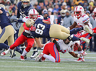 Annapolis, MD - November 11, 2017: Navy Midshipmen wide receiver Zack Fraade (83) gets tackled by several Southern Methodist Mustangs defenders during the game between SMU and Navy at  Navy-Marine Corps Memorial Stadium in Annapolis, MD.   (Photo by Elliott Brown/Media Images International)