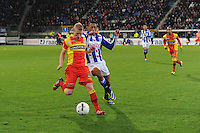 VOETBAL: ABE LENSTRA STADION: HEERENVEEN: 30-11-2013, SC Heerenveen - Go Ahead Eagles, uitslag 3-1, Doke Schmidt (#12 | GAE), Rajiv van La Parra (#7 | SCH), ©foto Martin de Jong