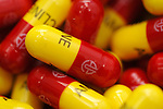 Clos eup of a varity of yellow and red Amicycline capsules. Royalty Free