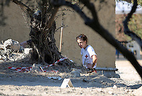 FAO JANET TOMLINSON, DAILY MAIL PICTURE DESK<br /> Pictured: A Red Cross volunteer conducting a search at the back of the house where Ben Needham disappeared from in Kos, Greece. Monday 03 October 2016<br /> Re: Police teams led by South Yorkshire Police, searching for missing toddler Ben Needham on the Greek island of Kos have moved to a new area in the field they are searching.<br /> Ben, from Sheffield, was 21 months old when he disappeared on 24 July 1991 during a family holiday.<br /> Digging has begun at a new site after a fresh line of inquiry suggested he could have been crushed by a digger.