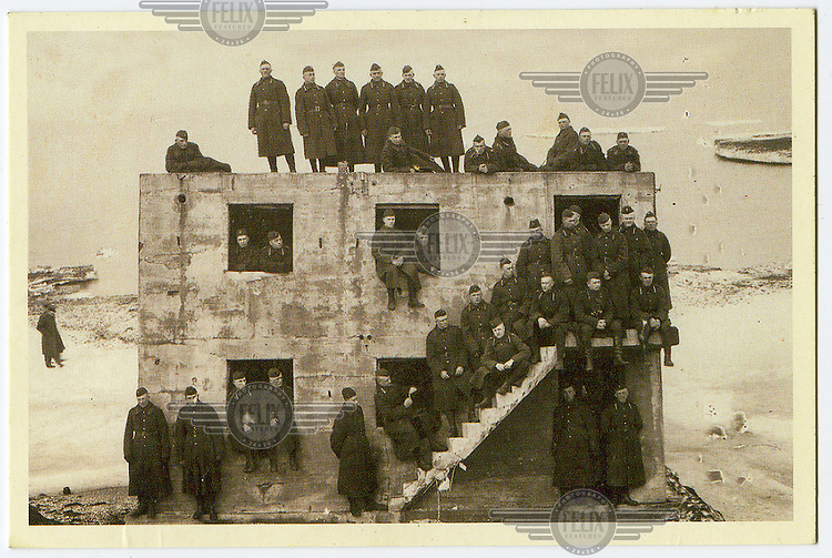 Latvian soldiers on the Karosta coastal bunker. The bunker, which now lies submerged in the Baltic Sea, was constructed between 1890-1906 as a naval base for the Russian Tsar Alexander III, and later served as a base for the Soviet Baltic Fleet during The Cold War.