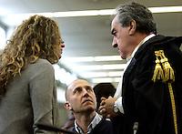 L'imputato Raniero Busco, in basso al centro, con la moglie Roberta Milletari', a sinistra, e l'avvocato Paolo Loria, durante l'udienza per il delitto della fidanzata Simonetta Cesaroni, presso l'aula bunker di Rebibbia, Roma, 16 febbraio 2010..UPDATE IMAGES PRESS/Riccardo De Luca
