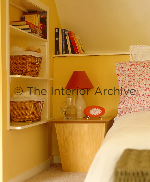 This country bedroom has a cheerful red and yellow colour scheme