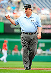 6 June 2010: MLB Umpire Joe West prepares for a game between the Cincinnati Reds and the Washington Nationals at Nationals Park in Washington, DC. The Reds edged out the Nationals 5-4 in a ten inning game. Mandatory Credit: Ed Wolfstein Photo