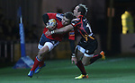 Dragons wing Will Harries tackles his opposite number Gerhard Van Den Heever.<br /> RaboDirect Pro12<br /> Newport Gwent Dragons v Munster<br /> Rodney Parade - Newport<br /> 29.11.13<br /> &copy;Steve Pope-SPORTINGWALES