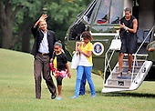 Washington, D.C. - August 30, 2009 -- United States President Barack Obama waves as he and his family return to the White House aboard Marine 1 after a week's vacation in Martha's Vineyard in Massachusetts on Sunday, August 30, 2009. From left to right: President Obama, Sasha Obama, Malia Obama, and first lady Michelle Obama..Credit: Ron Sachs / Pool via CNP