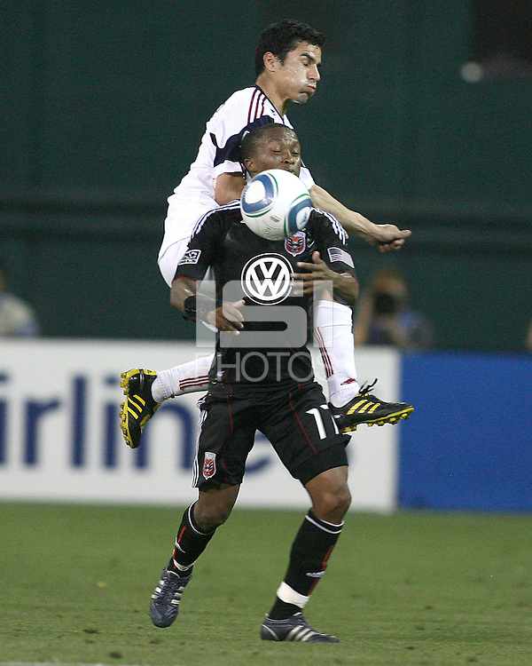 Boyzzz Khumalo #17 of D.C. United  is tackled from behind by Tony Beltran #2 of Real Salt Lake during an Open Cup match at RFK Stadium, on June 2 2010 in Washington DC. DC United won 2-1.