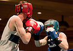 February 3, 2012:   Nevada boxerJarred Santos, right, during his bout against Air Force Academy boxer William Peterson in the 140 pound weight class at the Eldorado Convention Center on Friday night in Reno, Nevada.
