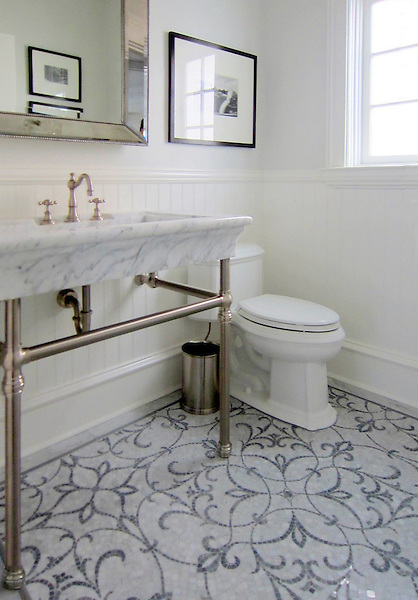 This custom bathroom features Marabel, a handmade mosaic shown in Carrara and Bardiglio, a part of the Silk Road Collection by Sara Baldwin for New Ravenna.<br />