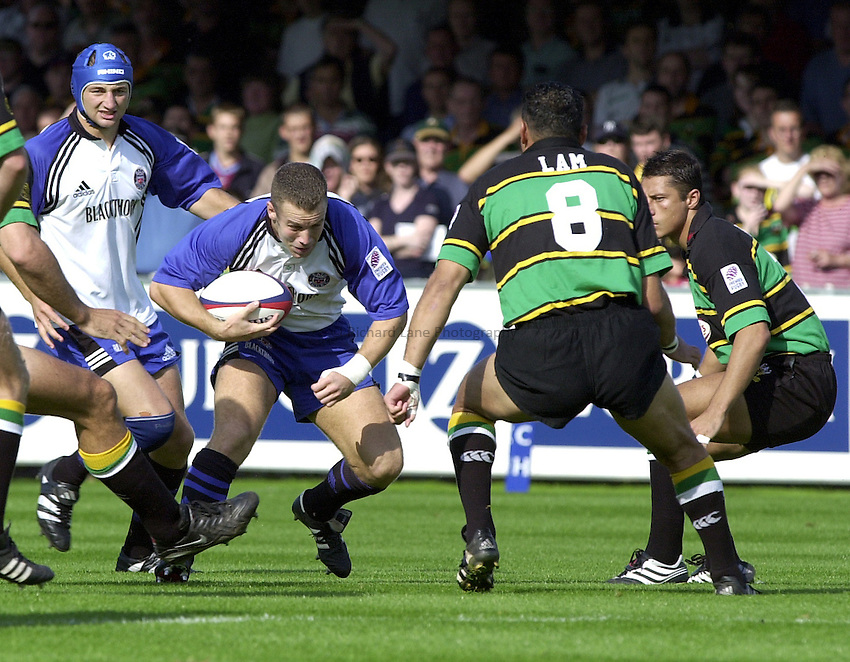 Photo. Richard Lane. .Northampton v Bath. Zurich Premiership. 23/9/2000.Kevin Maggs charges at Pat Lam and Luca Martin.